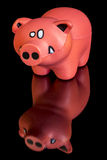 Little toy pig on a reflective table Stock Images
