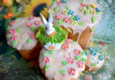 Little toy rabbit on traditional Easter cake Royalty Free Stock Image