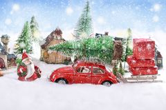 Little toy red car carrying christmas tree on the top Stock Photo