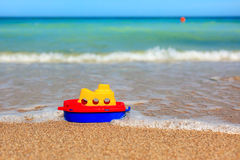 Little toy ship on beach Stock Photos