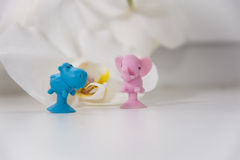 Little toys made of rubber. Little rubber toys shaped as hippopotamus and elephant Royalty Free Stock Photos