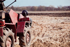 Little tractor a field in the spring Royalty Free Stock Photos
