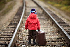 Little traveler with a old suitcase Stock Photography