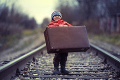 Little traveler with a old suitcase Royalty Free Stock Photo
