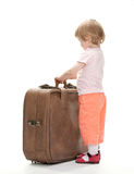 Little traveler preparing for a trip Stock Photos