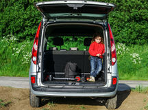 Little traveller in the car luggage. Little traveller staying in the car luggage. Family travel Stock Photos