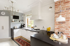 Little trendy kitchen. White and red brick in little trendy kitchen Stock Image