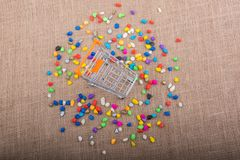 Little trolley amid Colorful pebbles Stock Images