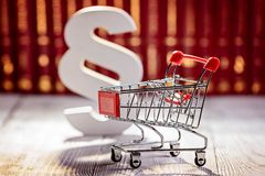Little trolley - pushcart with the symbols of law Royalty Free Stock Photography