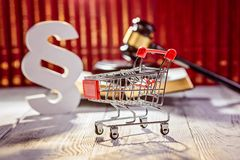 Little trolley - pushcart with the symbols of law royalty free stock photos