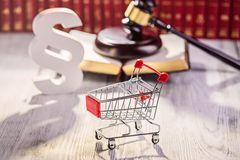 Little trolley - pushcart with the symbols of law Stock Photo