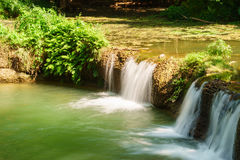 Little tropical waterfall in jungle in thailand Stock Photo