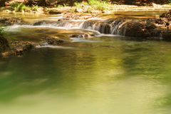 Little tropical waterfall in jungle in thailand Stock Image