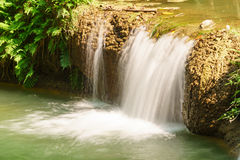 Little tropical waterfall in jungle in thailand Stock Photos
