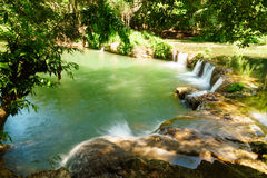 Little tropical waterfall in jungle in thailand Royalty Free Stock Photography