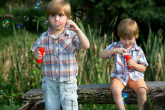 Little Twin Brothers Playing in Summer Park Royalty Free Stock Photo