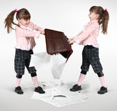 Little twin girls fighting Stock Photos