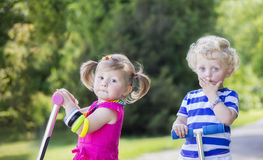 Little twins brother and sister. On summer day stock photography
