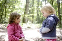 Little two sister girls in the beech forest Stock Images