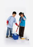 Little two workers with paint roller Stock Photos