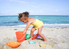 Little two year old girl at the beach Stock Images