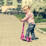 Little Two years old girl riding her scooter Royalty Free Stock Photography