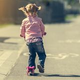 Little Two years old girl riding her scooter Royalty Free Stock Image
