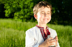 Little ukrainian boy drinks milk Royalty Free Stock Photo