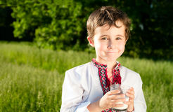 Little ukrainian boy drinks milk Royalty Free Stock Photos