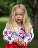 Little ukrainian girl. Little beautiful ukrainian girl stand and watching you royalty free stock image