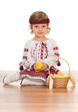 Little Ukrainian girl with Easter basket Stock Photos