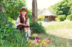 Little Ukrainian girl in  national costume in the Ukrainian vill Royalty Free Stock Photography