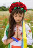 Little Ukrainian girl pray for peace Stock Photos