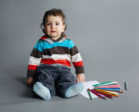 Little unhappy boy with pencils Royalty Free Stock Image