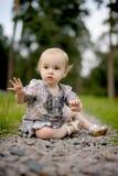 Little upset baby on the park alley. Little upset baby sitting on the park alley Stock Photos