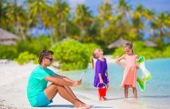 Little upset sad girls waiting father to swim Royalty Free Stock Image