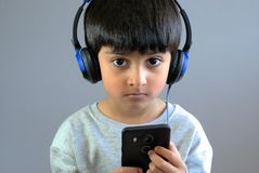 Little using smartphone stock images