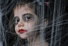 Little vampire girl. A girl with Halloween vampire make up Royalty Free Stock Images