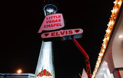 Little Vegas Chapel and Stratosphere hotel at night. Las Vegas, USA - 23 August 2016 - Little Vegas Chapel and Stratosphere hotel in the background stock images