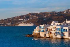 Little Venice on Mykonos and the cruise ship at sunset... Royalty Free Stock Image