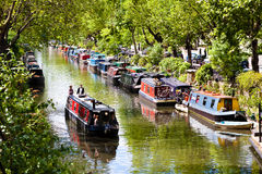 Little Venice, Regent`s Canal, London - England. London, England. May 25, 2014. Tourists strolling by boat in Little Venice, Regent`s Canal, London, England Royalty Free Stock Photos