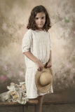 Little victorian girl. Sweet victorian girl posing in the old style Royalty Free Stock Photography