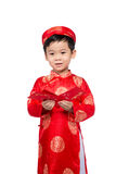 Little Vietnamese boy holding red envelops for Tet. The word mea. N double happiness. It is the gift in lunar new year or Tet Holiday on red isolate background Stock Photography