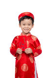 Little Vietnamese boy holding red envelops for Tet. The word mea. N double happiness. It is the gift in lunar new year or Tet Holiday on red isolate background Stock Photos