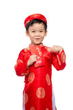 Little Vietnamese boy holding red envelops for Tet. The word mea. N double happiness. It is the gift in lunar new year or Tet Holiday on red isolate background Stock Image