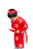 Little Vietnamese boy holding red envelops for Tet. The word mea. N double happiness. It is the gift in lunar new year or Tet Holiday on red isolate background Stock Photo