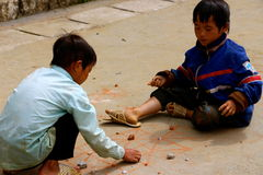 Little Vietnamese boys playing games on the path Stock Photo