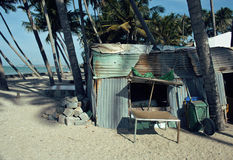 Little vietnamese house on seacoast among palms Royalty Free Stock Photo