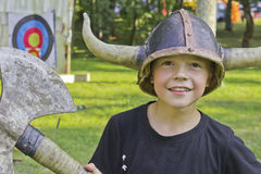 Little viking. Child in a viking helmet and ax Stock Images