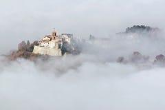 Little village in the fog Stock Image